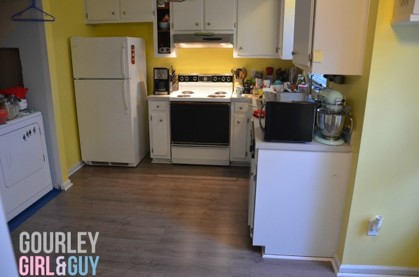kitchen-flooring-refrigerator-wall